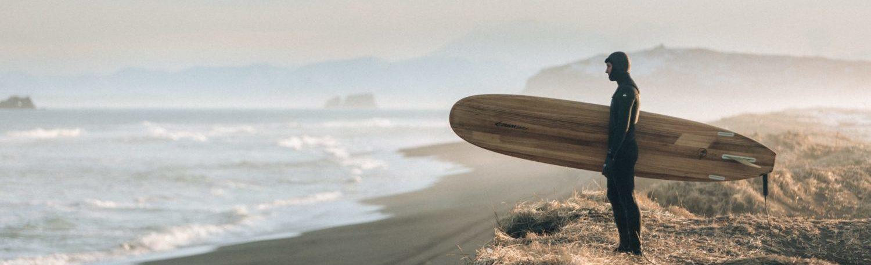 man-holding-surfboard-1553958
